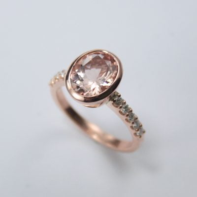 9ct Rose Gold Ring featuring an 11mm x 9mm Oval Cut Morganite plus 10x 2mm Round Brilliant Cut G / SI Diamonds totalling 0.30ct. Reference Code: LJ-R301-B
