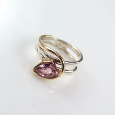9ct Yellow Gold and Silver Palladium Ring, featuring a Pear Cut Pink Tourmaline measuring approx. 9.25mm x 6.50mm. Reference Code: LJ-R310