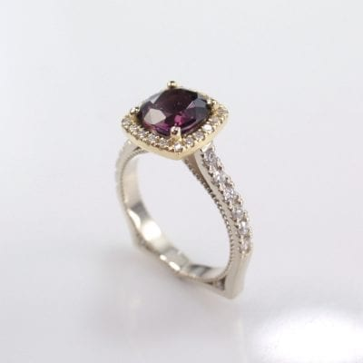 Beautiful 18ct Yellow and 9ct White Gold Ring featuring a 1.77ct Cushion Cut Spinel (7.50x7.00mm) plus a total of 0.41ct Round Brilliant Cut G/SI Diamonds (Shanks 12= 0.20ct, Halo 20= 0.16ct, Band 6= 0.05ct).  Reference Code: LJ-R335