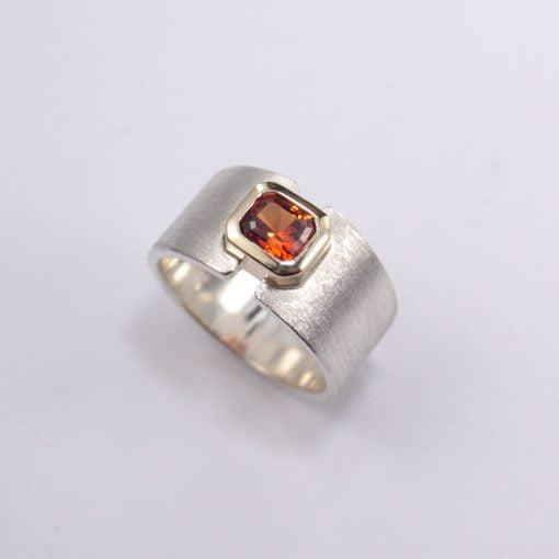 LJ-R341 - 9ct Yellow Gold and Silver/Palladium Ring, featuring a bezel set 1.13ct Emerald-Cut Spessatite Garnet (measuring 6.03x4.98mm).